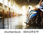 backpack and hat at the train... | Shutterstock . vector #404109379