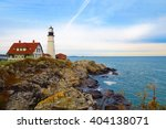 lighthouse on the rocks ... | Shutterstock . vector #404138071
