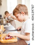 small boy cooking together with ... | Shutterstock . vector #404139787