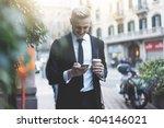 happy smiling businessman going ... | Shutterstock . vector #404146021