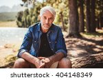 Portrait Of Mature Man Sitting...
