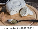 homemade cheese with oregano... | Shutterstock . vector #404223415