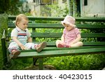 Boy And Girl On The Bench In...