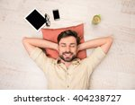 portrait of happy man lying on... | Shutterstock . vector #404238727