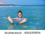 girl at the dead sea  israel. | Shutterstock . vector #404249854