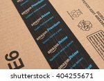 Small photo of DIVACA. SLOVENIA - APR 11, 2016: Amazon Prime logotype on cardboard parcel box sticky paper scotch tape. Amazon Prime is premium service of Amazon shop for fast parcels delivery.
