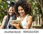 afro women using tablet... | Shutterstock . vector #404261434