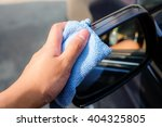 hand wash a wing mirror with... | Shutterstock . vector #404325805