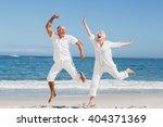 Senior Couple Jumping At The...