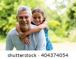smiling grandfather carrying... | Shutterstock . vector #404374054