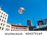 Small photo of WELLINGTON, NEW ZEALAND - NOVEMBER 18, 2014: Silver fern-patterned filagree suspended globe, Civic Square, Wellington, New Zealand.