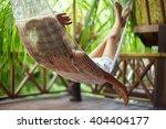young beautiful woman relaxing... | Shutterstock . vector #404404177