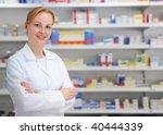 portrait of a female pharmacist at pharmacy - stock photo