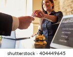 Small photo of Guest takes room key card at check-in desk of hotel, close up