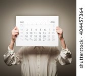 woman is holding may calendar... | Shutterstock . vector #404457364