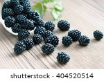 Blackberries In Bowl On Wooden...