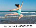 Girl Dancing In The Beach