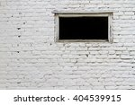 White Brick Wall With A Window...