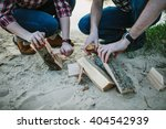 young couple make fireplace on... | Shutterstock . vector #404542939