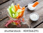 the sticks of carrots and... | Shutterstock . vector #404566291