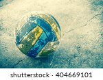old volleyball on grunge cement ... | Shutterstock . vector #404669101