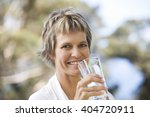 woman drinking a glass of water | Shutterstock . vector #404720911