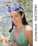 a female snorkeler holding a... | Shutterstock . vector #404725984