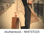 woman in a light coat  with a... | Shutterstock . vector #404737225