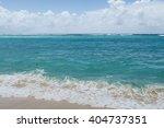 sandy blue beach with waves ...   Shutterstock . vector #404737351