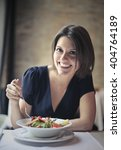 happy woman eating vegetables | Shutterstock . vector #404764189