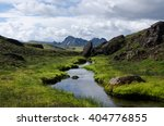 river in iceland surrounded... | Shutterstock . vector #404776855