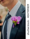 pink orchid boutonniere on the... | Shutterstock . vector #404789809