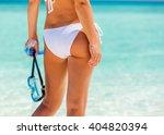 back of young woman in bikini... | Shutterstock . vector #404820394