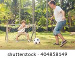 father and son playing in the... | Shutterstock . vector #404858149