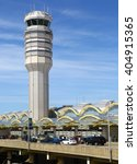Small photo of Arlington County, Virginia, United States - August 13, 2015: Air Traffic Control Tower and Terminal C of Ronald Reagan International Airport.