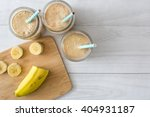 banana smoothie on a white... | Shutterstock . vector #404931187