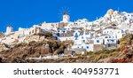 oia village on santorini... | Shutterstock . vector #404953771