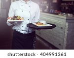 waiters carrying plates with... | Shutterstock . vector #404991361
