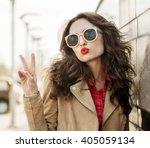 pretty woman blowing lips kiss. ... | Shutterstock . vector #405059134