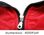 metal zipper from red coat on white background - stock photo