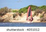 fast moving windsurfer on the... | Shutterstock . vector #4051012