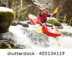 A Whitewater Kayaker Going Ove...