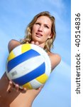 Beautiful beach volleyball female player with a ball - stock photo