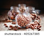 raw peanuts in a glass jar on... | Shutterstock . vector #405267385