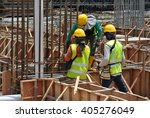 Small photo of MALACCA, MALAYSIA -MARCH 13, 2016: Construction workers at the construction site in Malaysia. All of them is required to wear adequate safety equipment during works to make sure their safety.