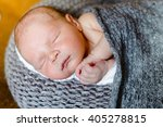 sleeping newborn baby wrapped... | Shutterstock . vector #405278815
