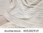 white knitted blanket.  lying... | Shutterstock . vector #405282919