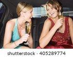 two women drinking champagne in ... | Shutterstock . vector #405289774