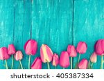 Frame Of Tulips On Turquoise...