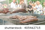 a man turning over a piece of... | Shutterstock . vector #405462715